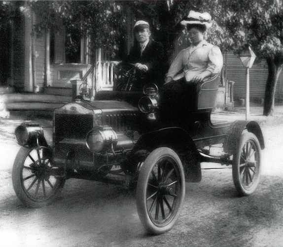 "Dr. and Mrs. Robert B. Hopkins out for a ride in one of the first automobiles owned by a Milton resident. The photo appeared in ""It Began With A River,"" by Jane Donovan, and is used by permission of the Milton Historical Society."